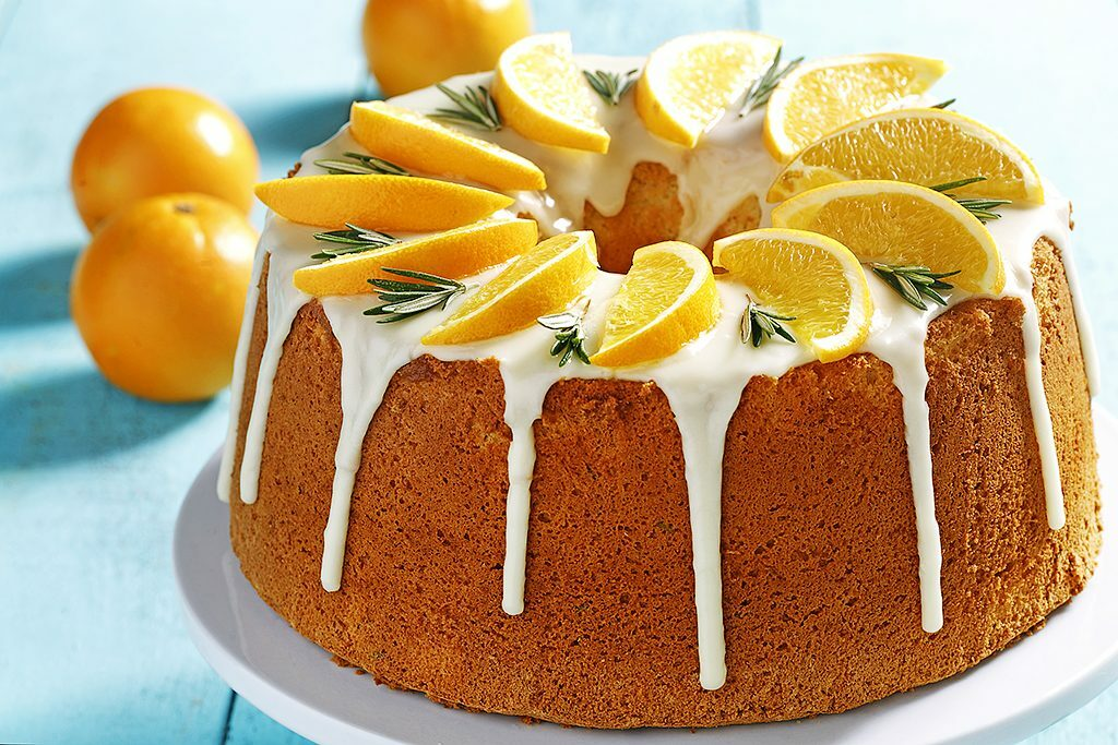 Tall chiffon cake with rosemary and orange zest.